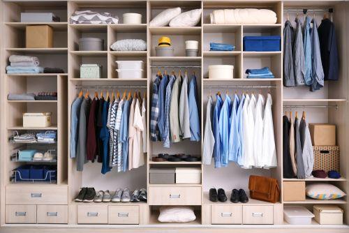 A wardrobe organized through the Konmari method.
