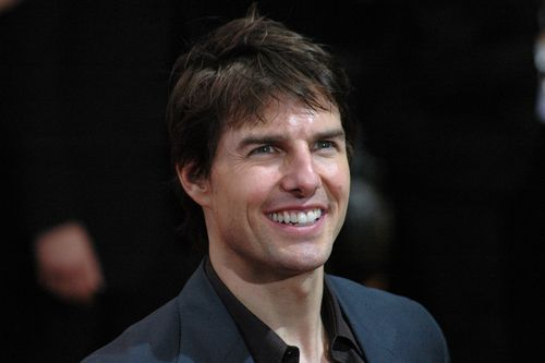 Tom Cruise smiling for his fans.