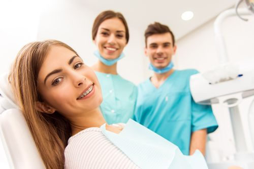 a smiling woman after getting braces