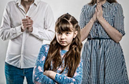 Stubborn girl not listening to her parents.