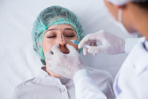 Woman getting a nose job done.