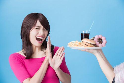 Woman saying no to junk food.