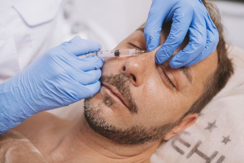 A man getting a liquid filler injected into his nose.