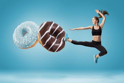 Woman kicking away donuts.