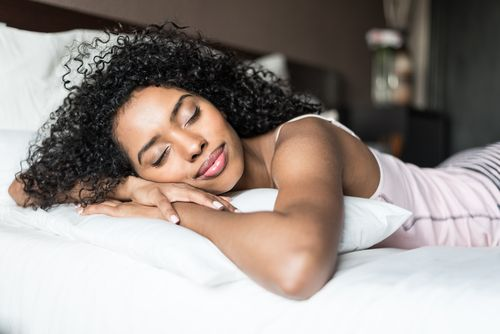 African woman sleeping peacefully.