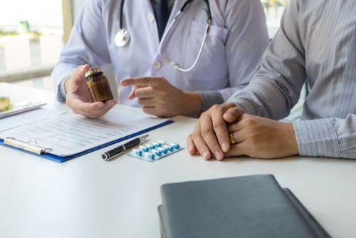 Doctor prescribing medication to patient.