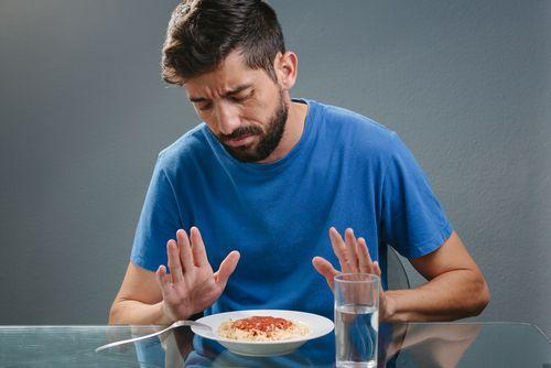 Man not eating food.